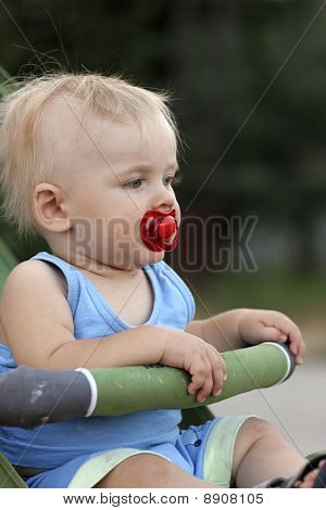 Baby Sits In Perambulator