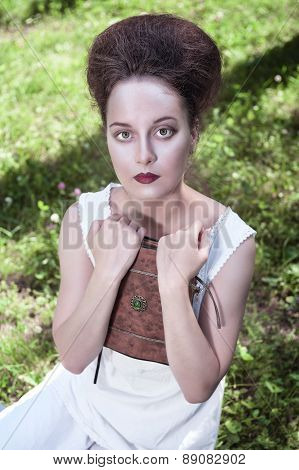 Beautiful Young Gothic Woman In White Shirt With Book