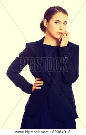 Young blonde beautiful businesswoman thinking