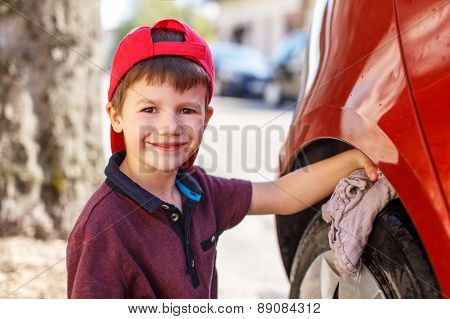 Little Boy Cleaning Red Car