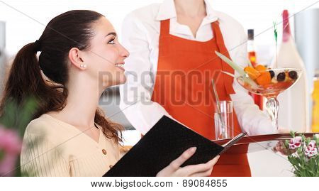 girl in coffee is served with a ice cream