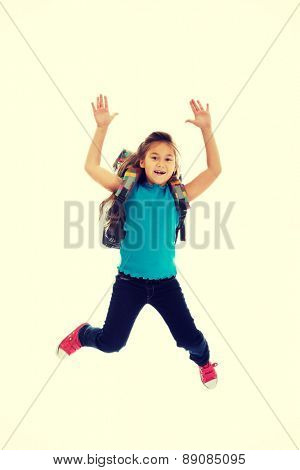 Schoolgirl with bag jumping high