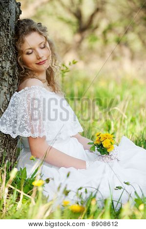 Pretty Woman With Flower In Park