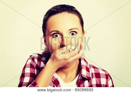 Young beautiful woman eating popcorn