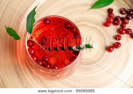 Compote with red currant on wooden tray background