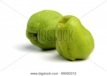 Closeup of quince on white background