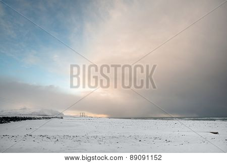 View of snow covered mountains, plains and beaches in southern Iceland during a winter morning.