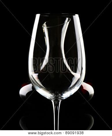 Glass carafe of wine on dark background