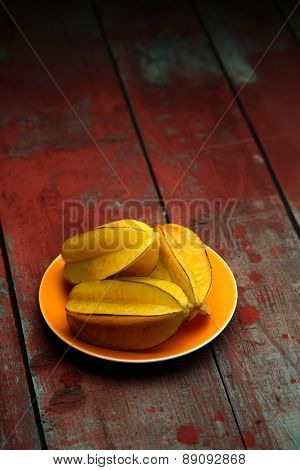 Carambola fruit on wooden background