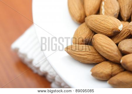 Close-up of almonds on white plate