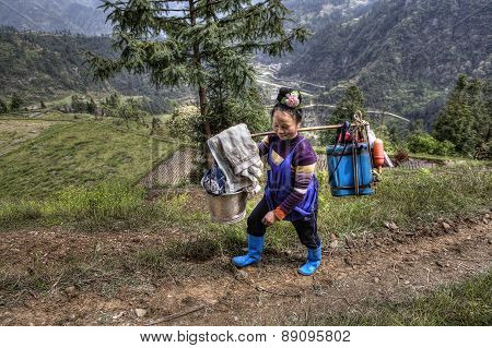 Chinese Woman Farmer Peasant Carries The Weight On Your Shoulder
