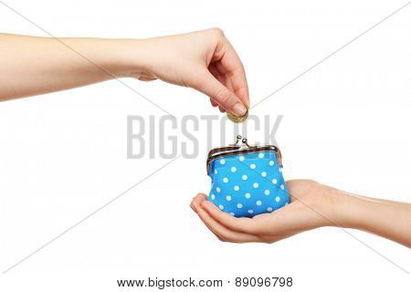 Female hand putting coin into purse isolated on white