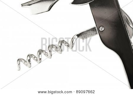 Close-up of corkscrew on white background