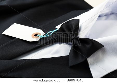 Price tag on white shirt and black jacket, close-up