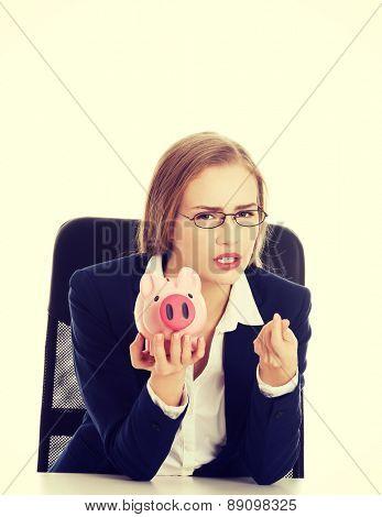 Young businesswoman holding a piggybank