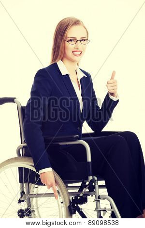 Smiling caucasian businesswoman on a wheelchair