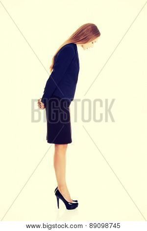 Young business woman looking down
