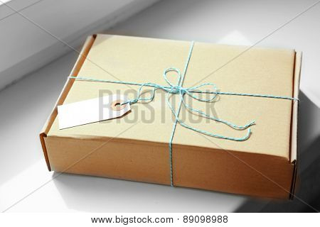 Mail package parcel on white background, closeup