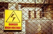 picture of transformer  - Danger high voltage warning sign on a fence in transformer station - JPG