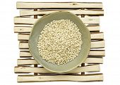 image of ceramic bowl  - sprouted brown rice in a ceramic bowl on a wood stick trivet - JPG