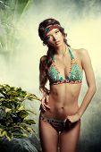 pic of tropical plants  - Beautiful sexy woman in bikini among tropical plants - JPG