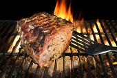 pic of flame-grilled  - Spatula and BBQ Grilled Pork Chop With Ribs On The Hot Grill - JPG