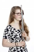 picture of flute  - teenage girl stands pensive with flute against white background - JPG