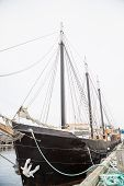 pic of mast  - An old wood three masted schooner with a white traditional anchor - JPG