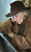 stock photo of gunslinger  - Mature female Bandit with gun in the wild west - JPG