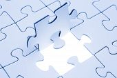 pic of jigsaw  - Jigsaw piece blue toned Jigsaw and puzzles concepts - JPG