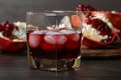 foto of pomegranate  - pomegranate juice with ice and red pomegranate fruit