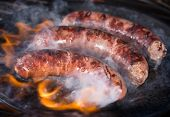 stock photo of braai  - Grilled sausages on the grill - JPG