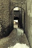 foto of italian alps  - Rustic arched street in a old alpine village - JPG