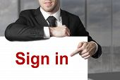 picture of intranet  - businessman in black suit pointing on sign in - JPG