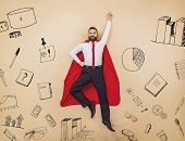 picture of cloak  - Manager in a superman pose wearing a red cloak - JPG