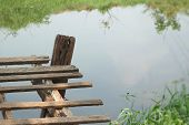 foto of old bridge  - Old wooden bridge on the lake with nature - JPG