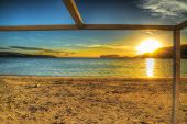 picture of shoreline  - colorful sunset by the shoreline - JPG