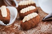 image of cake-ball  - Chocolate rum balls cakes decorated with cream and cocoa - JPG
