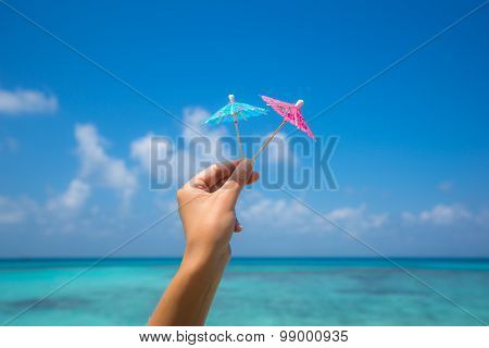 Picture Of Cocktail Umbrella On The Tropical Beach, Vacation. Traveller Dreams Concept