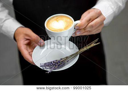 Holding lavander cappuccino