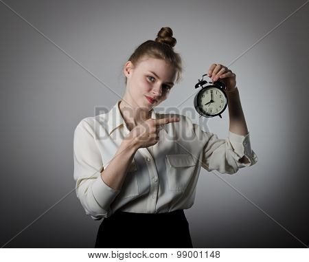 Girl Pointing At A Clock.
