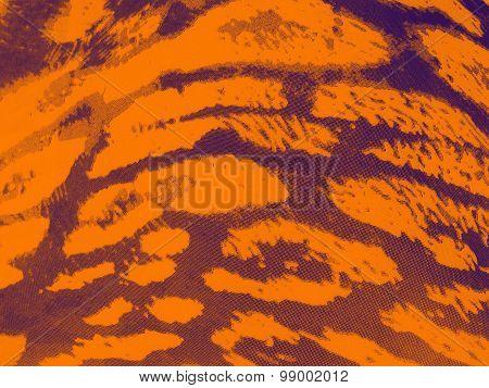 Orange-purple gradiented leopard textile background