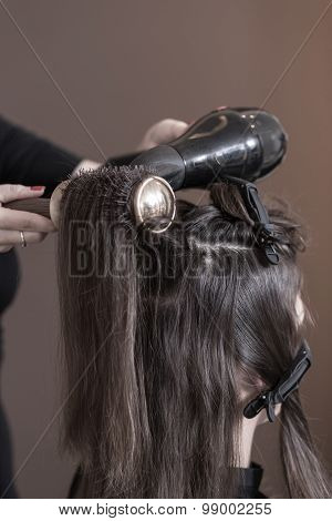 Hair Stylist Using Hairdryer