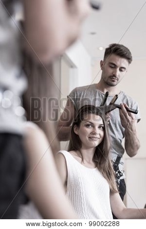Straightening Hair In Hairdresser Salon