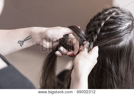 Hairdresser Making A Braid