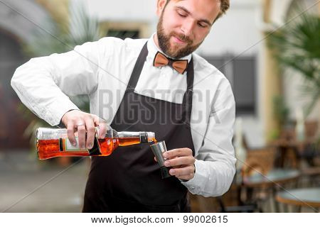 Barman pouring Aperol