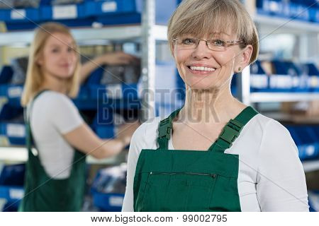 Satisfied Woman In The Factory