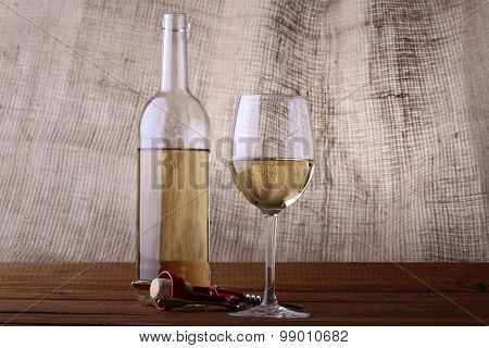 Wine Bottle With Glass And Corkscrew