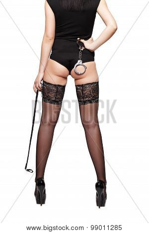 Sexy Woman Body In Stockings With Whip And Handcuffs
