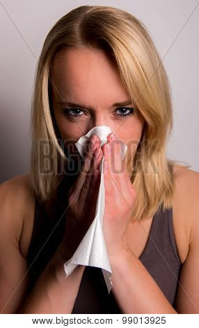 Young Woman Blows Her Nose